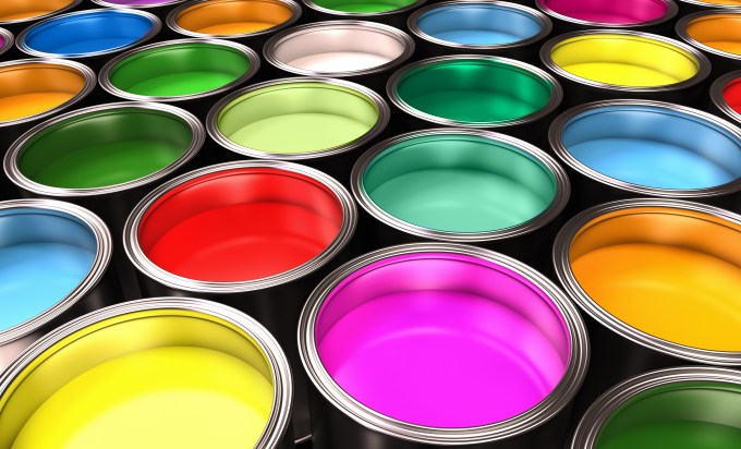 open paint cans with bright colors