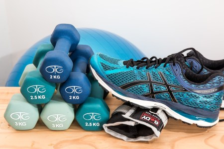 dumbbells, sneakers and exercise equipment