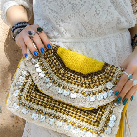 Model Wearing Sterling Silver Gemstone rings and Hand Embroidered Clutch Bag