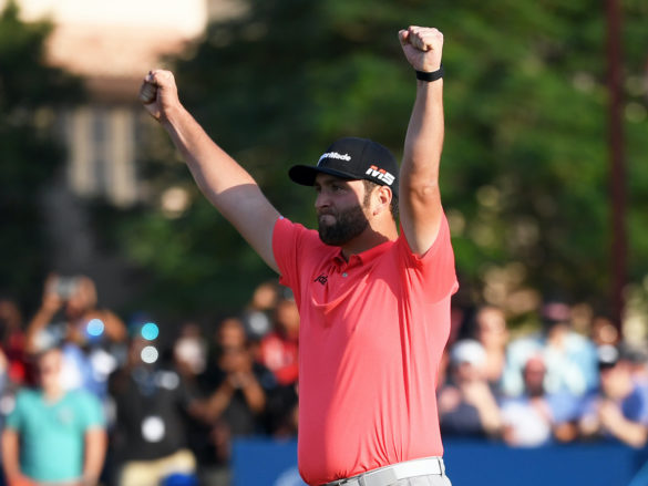 DUBAI, UNITED ARAB EMIRATES - NOVEMBER 24: Jon Rahm of Spain celebrates after putting in for a birdie on the eighteenth green to win the DP World Tour and Race to Dubai during Day Four of the DP World Tour Championship Dubai at Jumerirah Golf Estates on November 24, 2019 in Dubai, United Arab Emirates. (Photo by Ross Kinnaird/Getty Images)