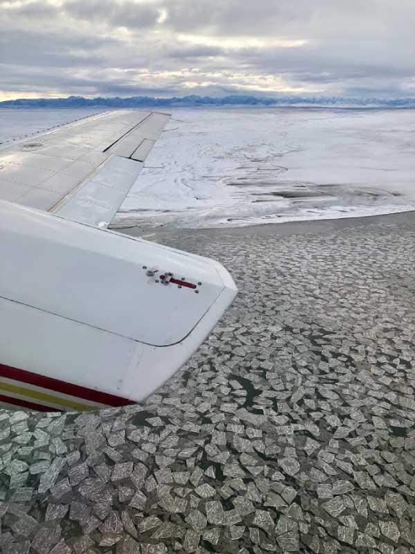 Plane flying over the Artic coast on the Polar Bear Adventure Tour