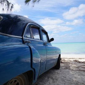 Where else can you find classic cars parked on uncrowded white sand beaches in the Caribbean?!