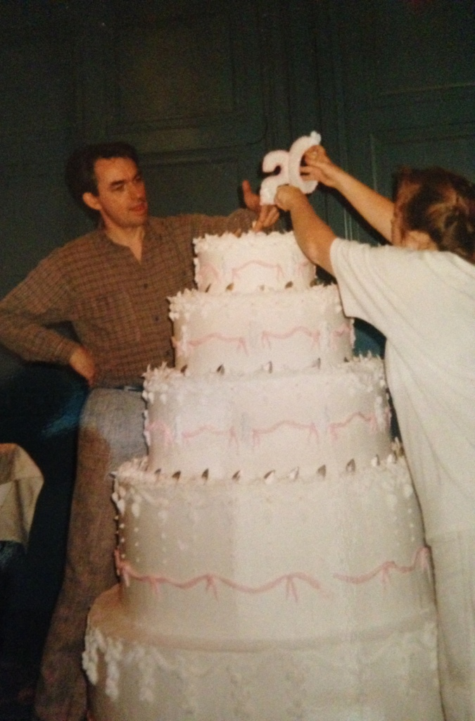 """Donna and I topping off a cake for some company's 20th anniversary. Cake is styro with twinkly lights inset and shortening and sugar frosting. It was an engineering exercise - not catering."""