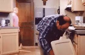 George Costanza retrieving eclair from trash