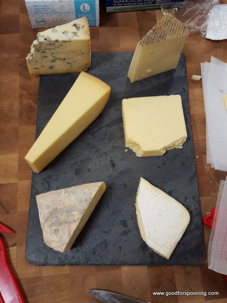 clockwise from upper left: Stilton, Manchego, Aged English Cheddar, Robiola Bosina, Taleggio, Parrano on a slate board. Everything and the board available for sale!