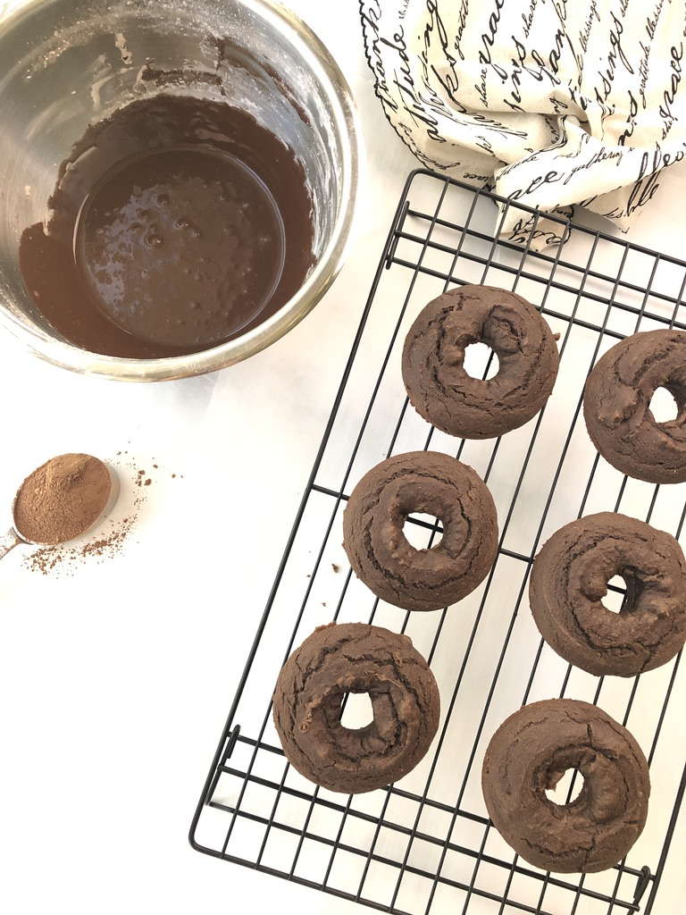 Donuts getting ready for chocolate glaze