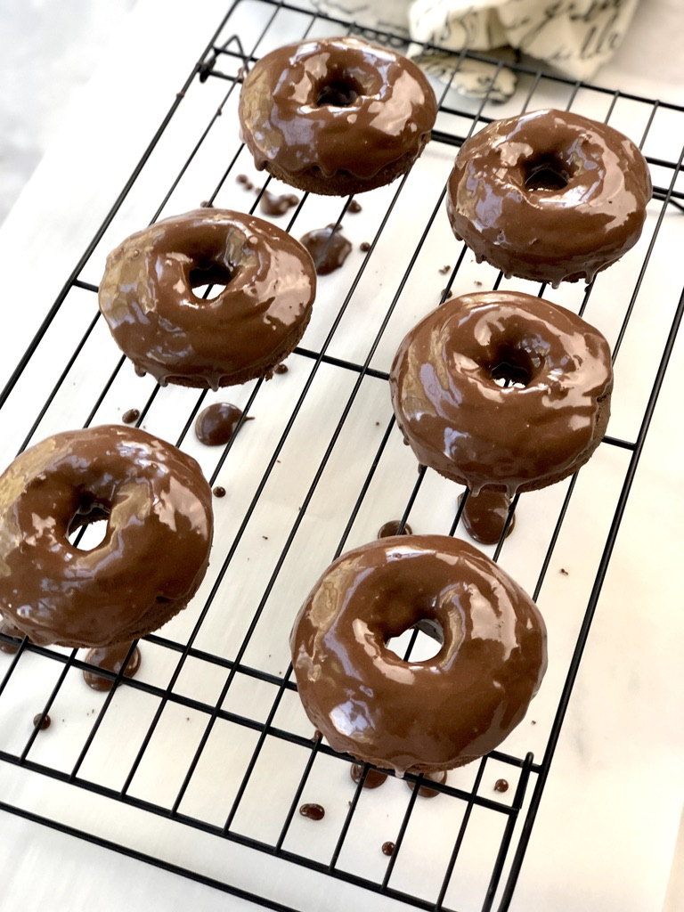 Chocolate glaze dripping off donuts