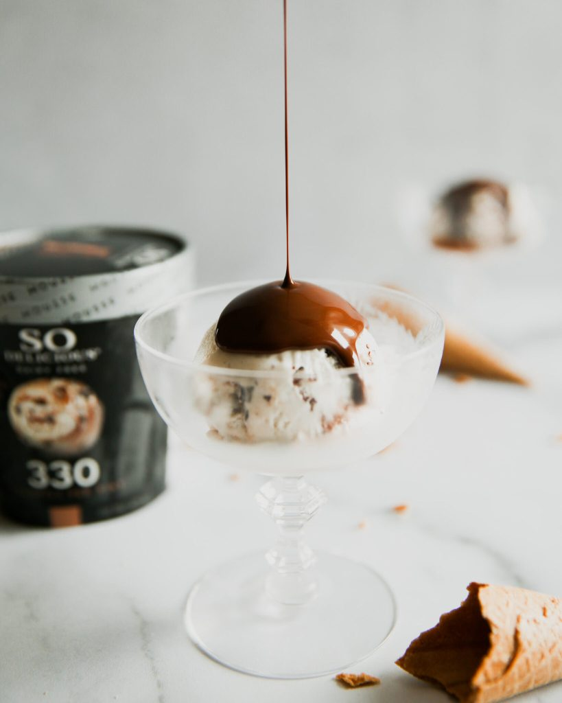 Pouring homemade magic shell over frozen mousse ice cream