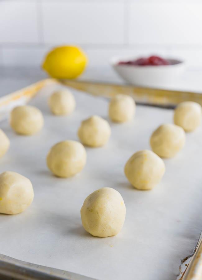 Gluten free thumbprint cookies rolled into dough balls