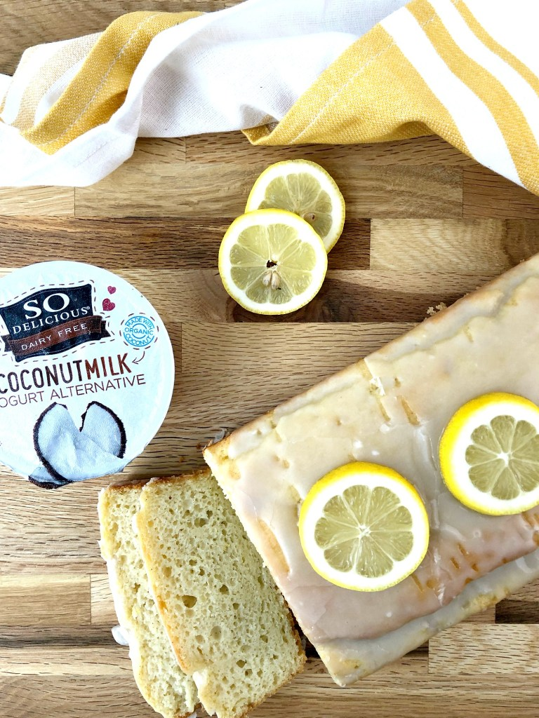 Gluten-Free Lemon Vanilla Pound Cake with So Delicious coconutmilk yogurt alternative overhead view with lemon slices