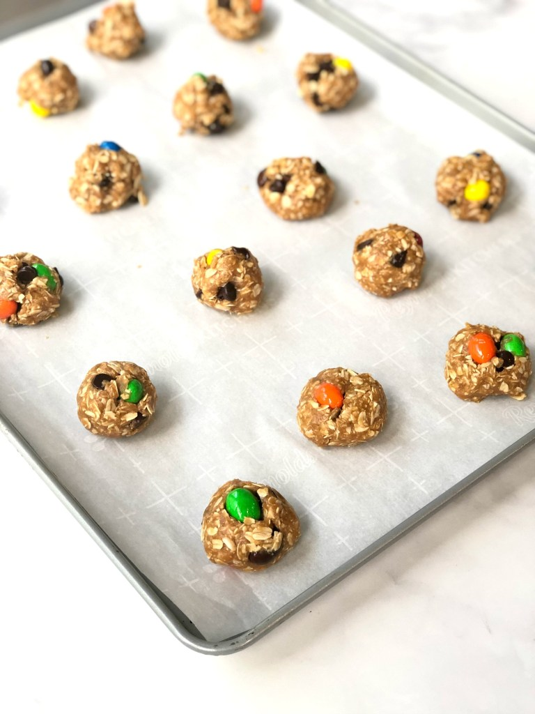 gluten-free monster cookie dough balls on baking sheet