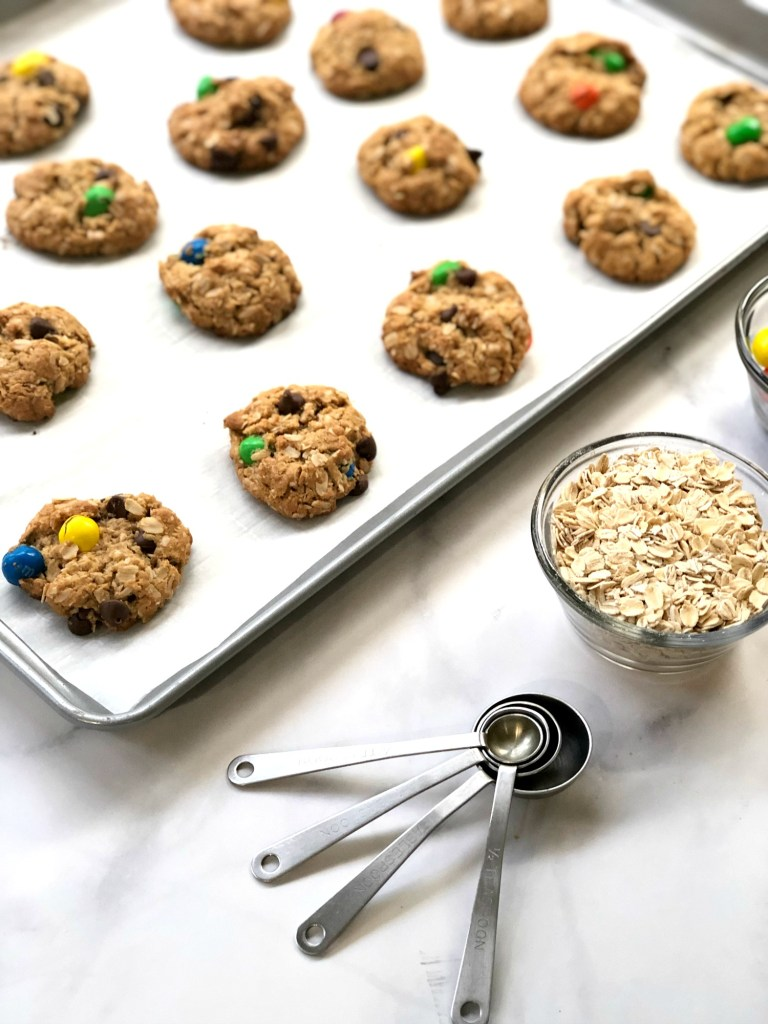 gluten-free monster cookies baked on a cookie sheet