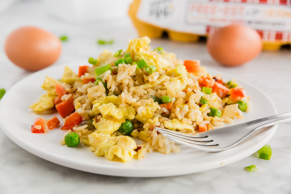 Plate of egg fried rice with a fork