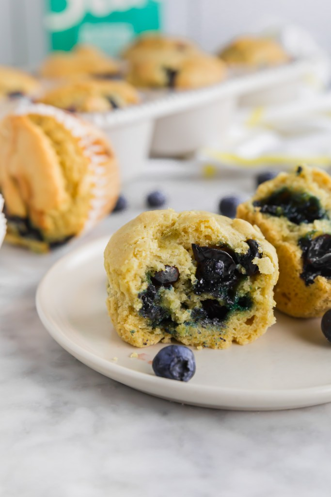 Inside of the gluten-free blueberry muffins with blueberries gushing out