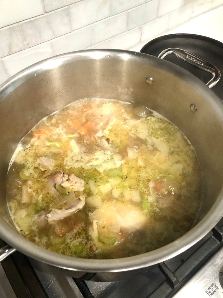 gluten-free chicken soup simmering in a pan