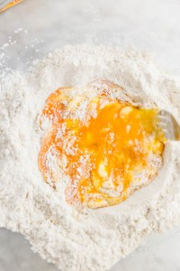 Eggs and flour being whisked together