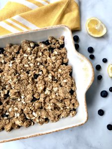 Blueberry crisp covered in oats and flour mixture