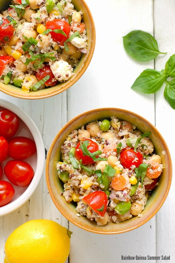 Two Rainbow Quinoa Summer Salads with quinoa, tomatoes, corn, cheese and more by Boulder Locavore