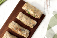 Picture of rice wrappers holding in deconstructed egg roll filling