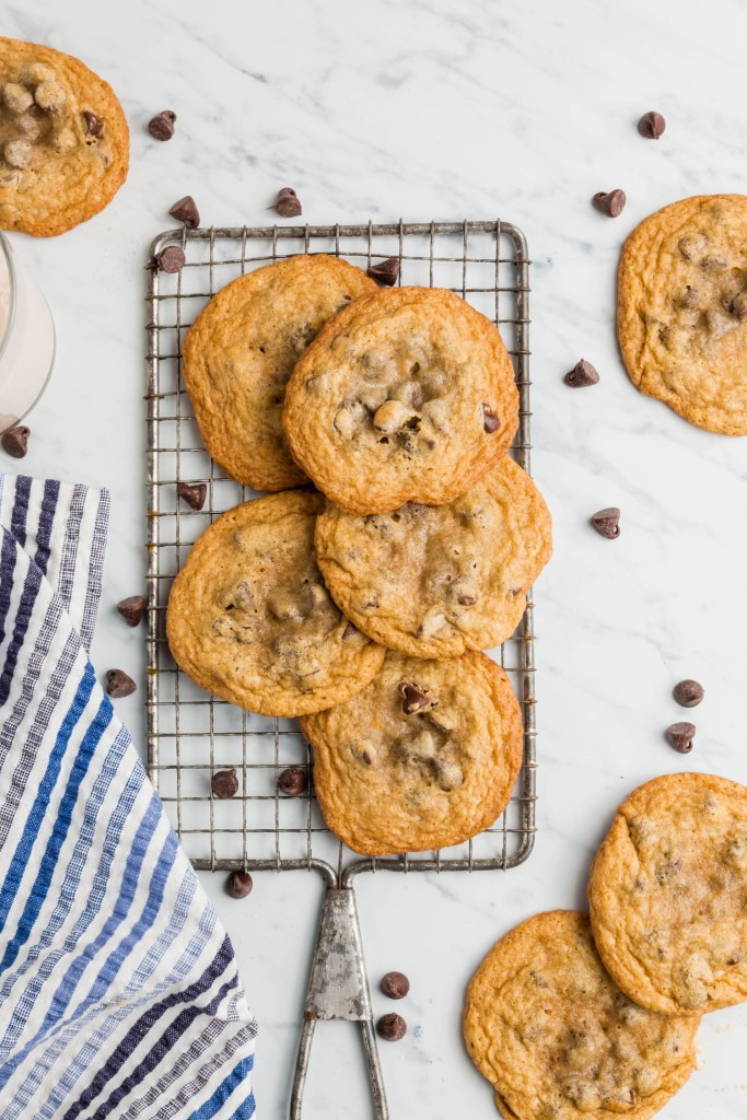 Overhead view of gluten-free chocolate chip cookies on a wire baking rack.