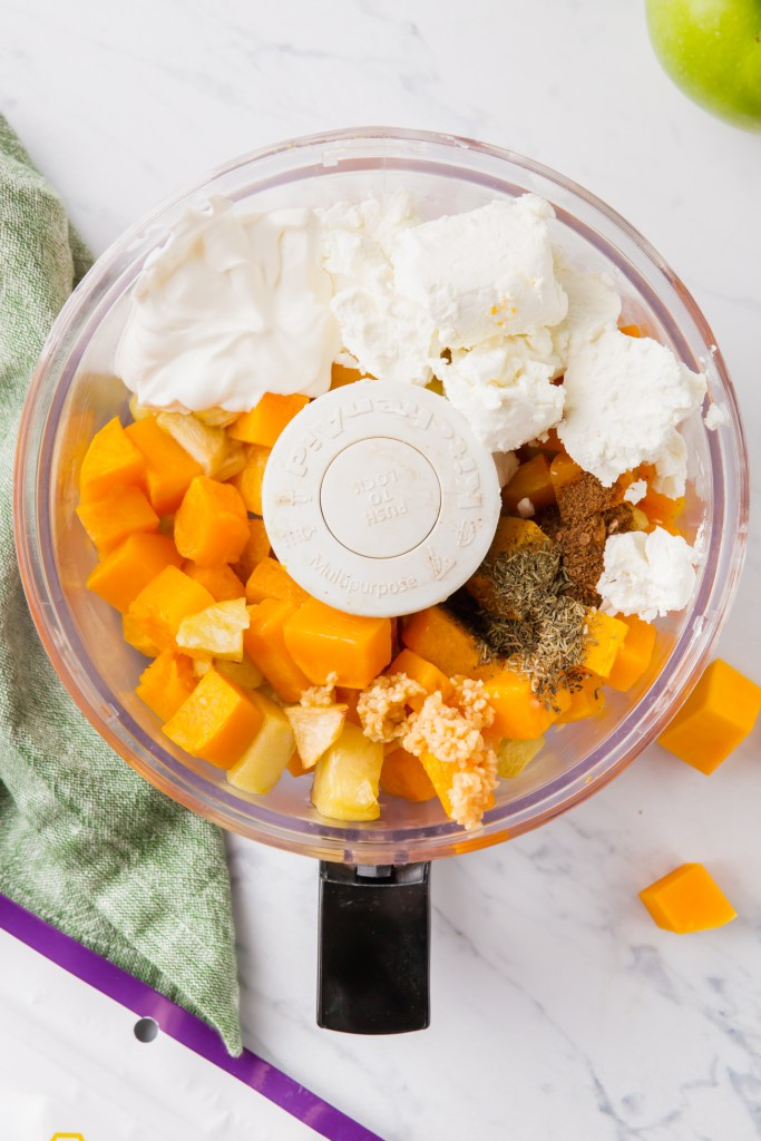 Butternut squash and other ingredients in food processor