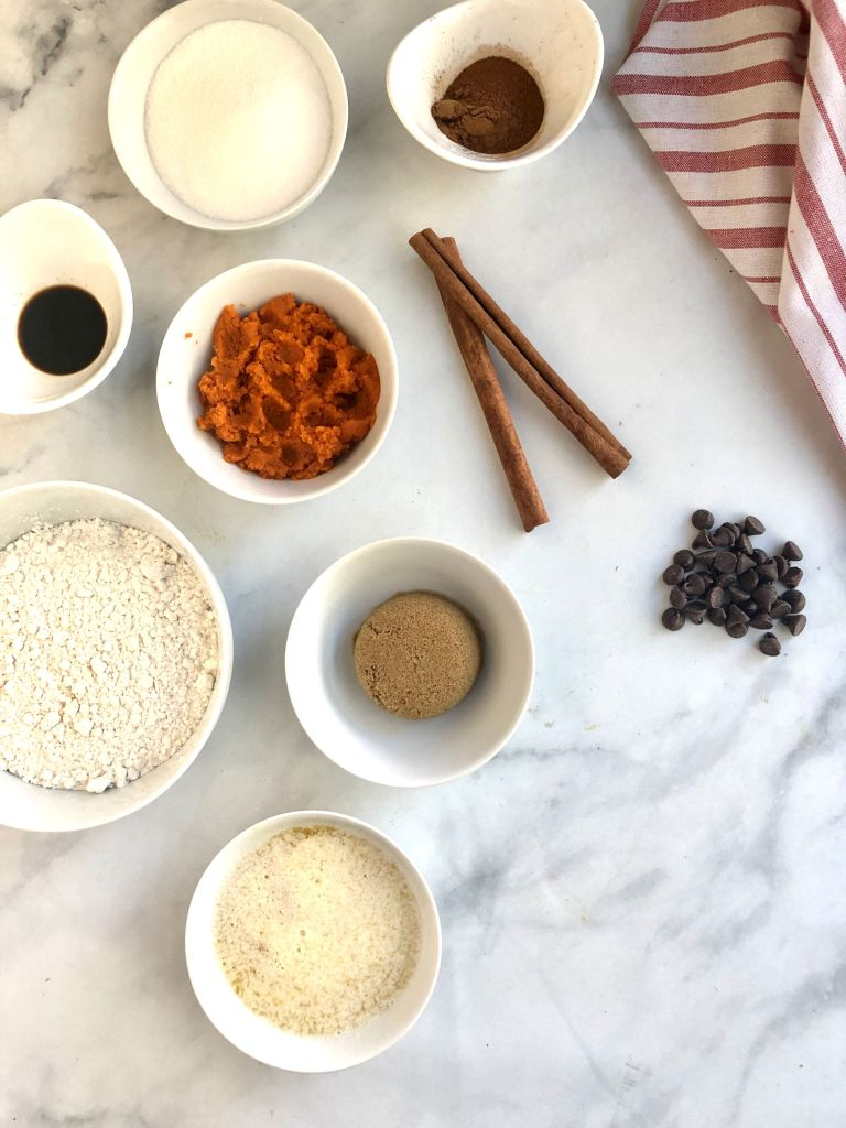 Picture of all the ingredients needed to make the gluten-free pumpkin chocolate chip cookies including melted butter, pumpkin puree, sugar and flour.