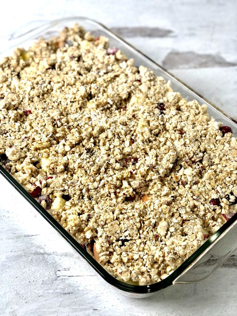 Picture of uncooked apple cranberry crisp with topping