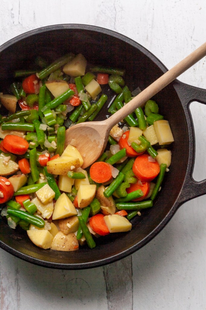 Pot of potatoes and vegetables sauteing