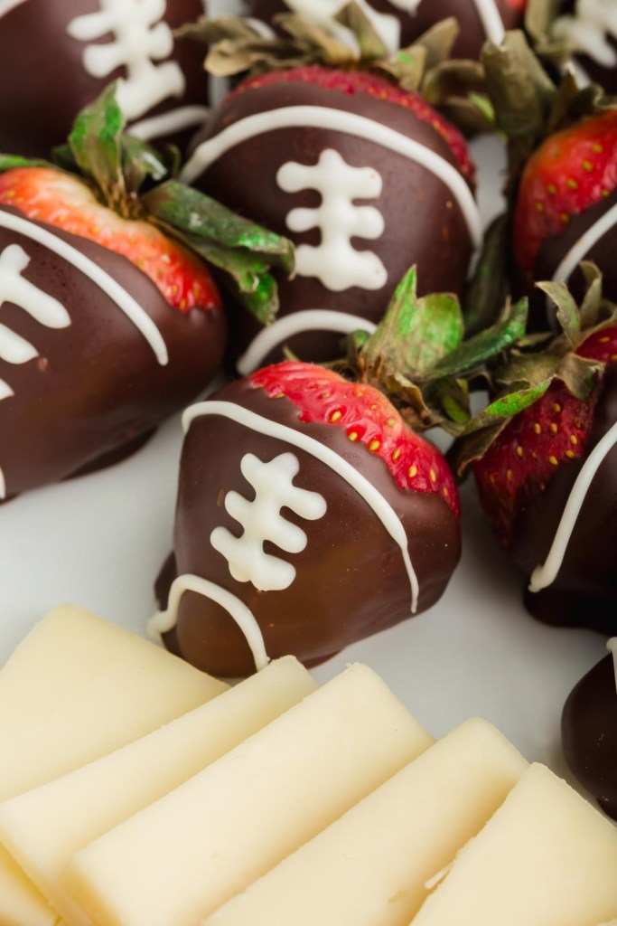 Chocolate covered football strawberries upclose
