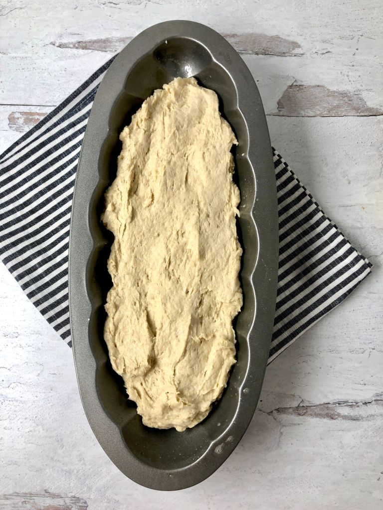 Picture of gluten-free challah in metal challah mold pan