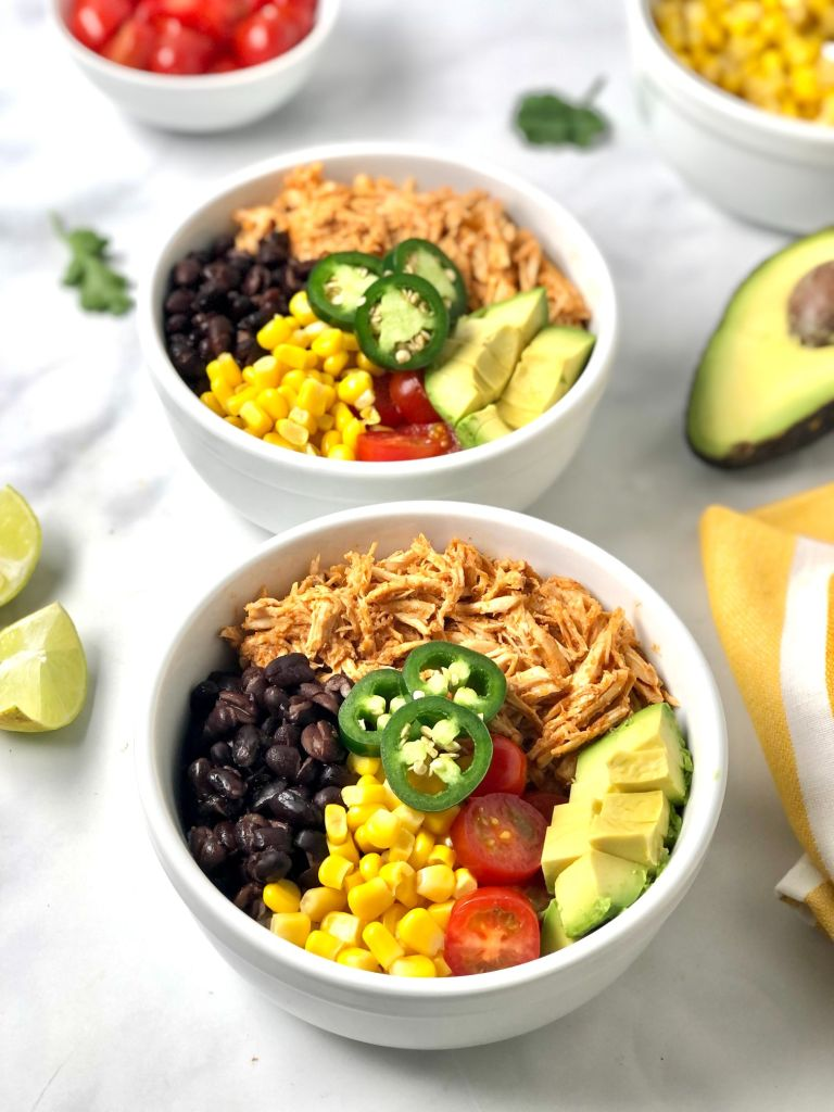 Up close on two chicken enchilada bowls
