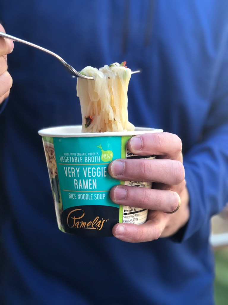Holding a Pamela's gluten-free ramen noodle cup of soup
