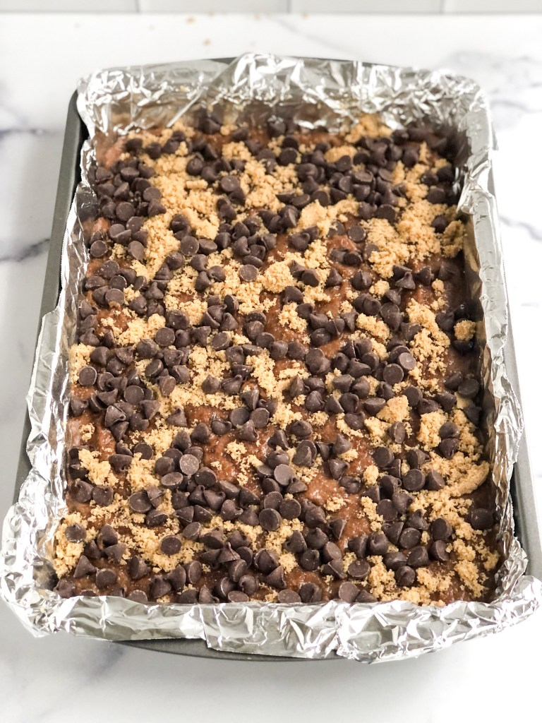 Cake coated with brown sugar and chocolate chips before baking