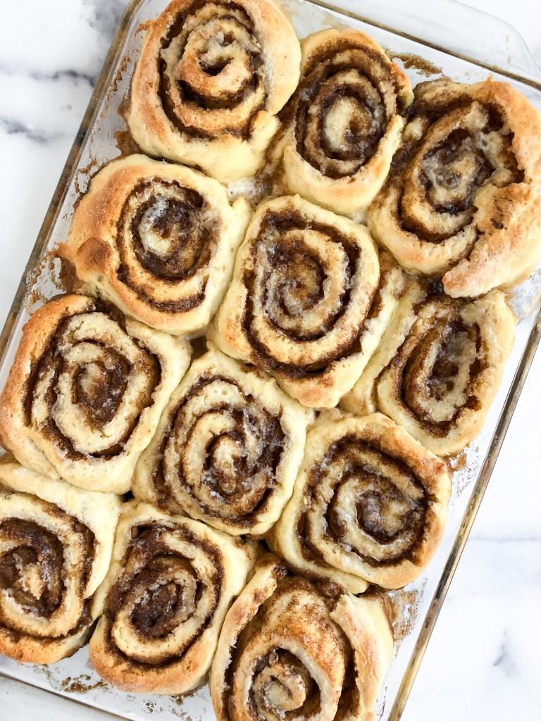 Baked gluten-free cinnamon rolls in a casserole dish