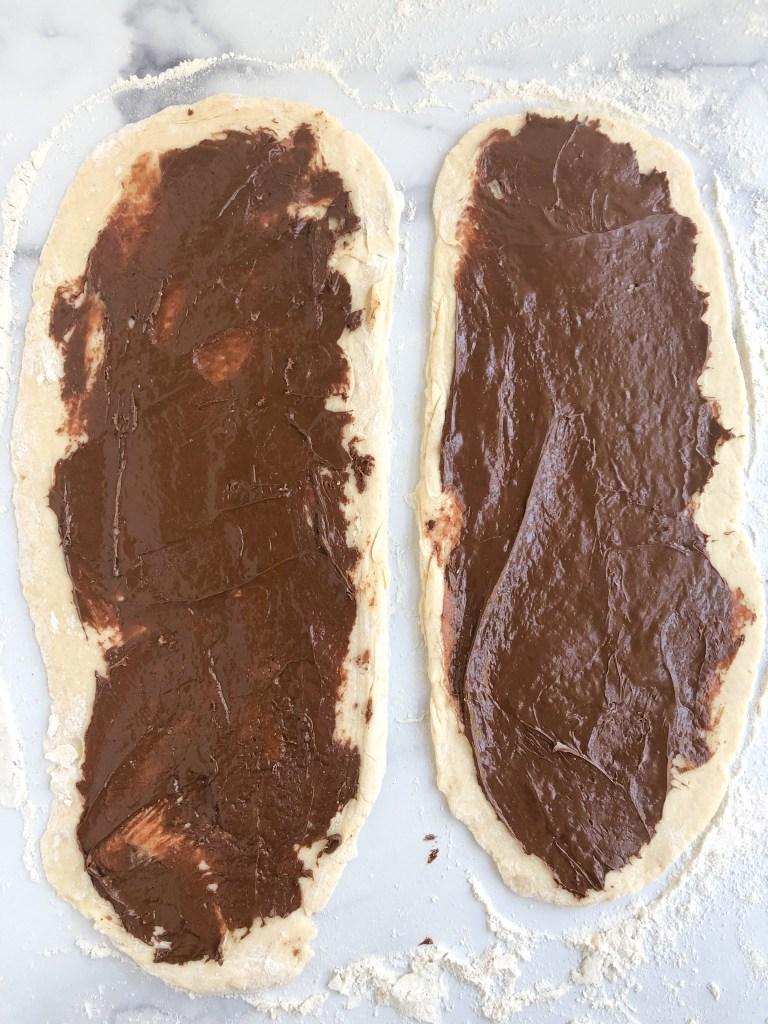 Babka dough covered in Nutella