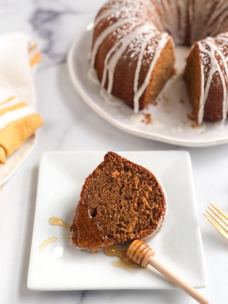 slice of gluten-free honey cake with splash of honey on top of it