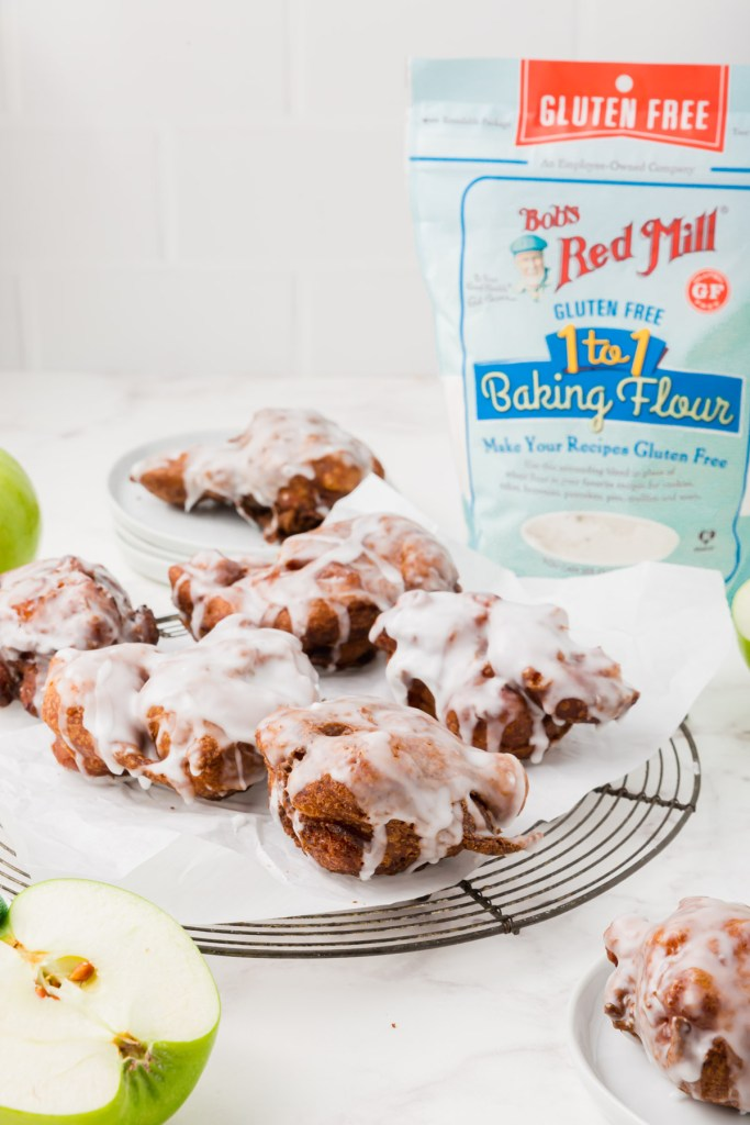 Apple fritters on wire rack with Bob's Red Mill flour