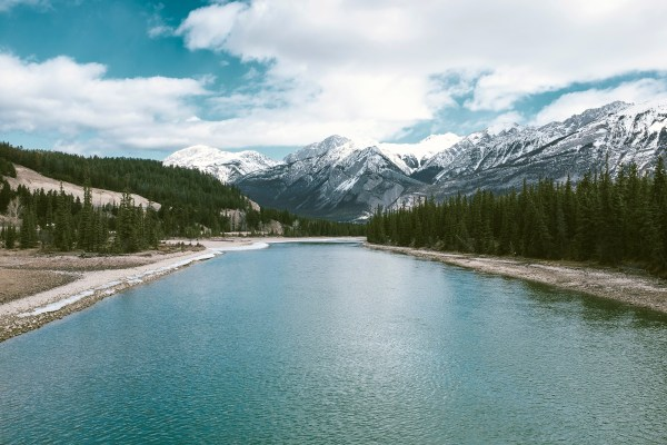 Scenic River Landscape And Mountains In Jasper National