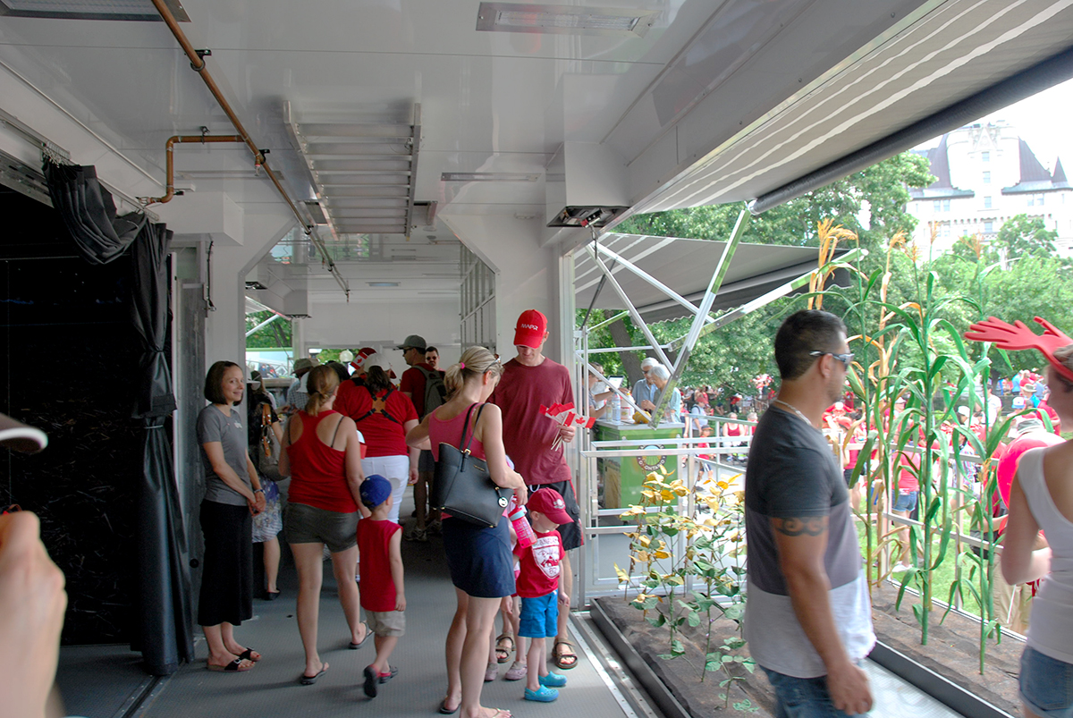Visitors in the Growing Connections trailer on Canada Day