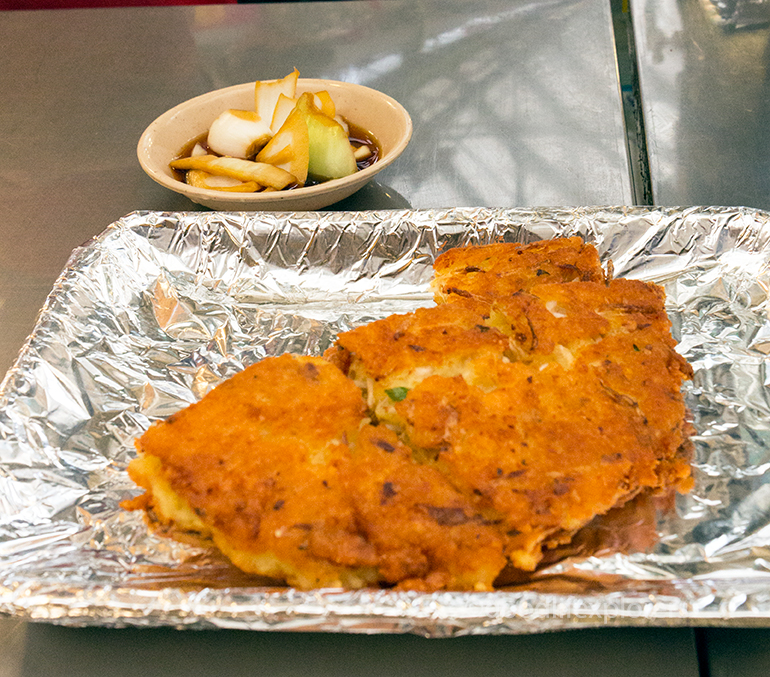 Bindaetteok (mungbean pancake) at Gwangjang Market, Seoul, South Korea