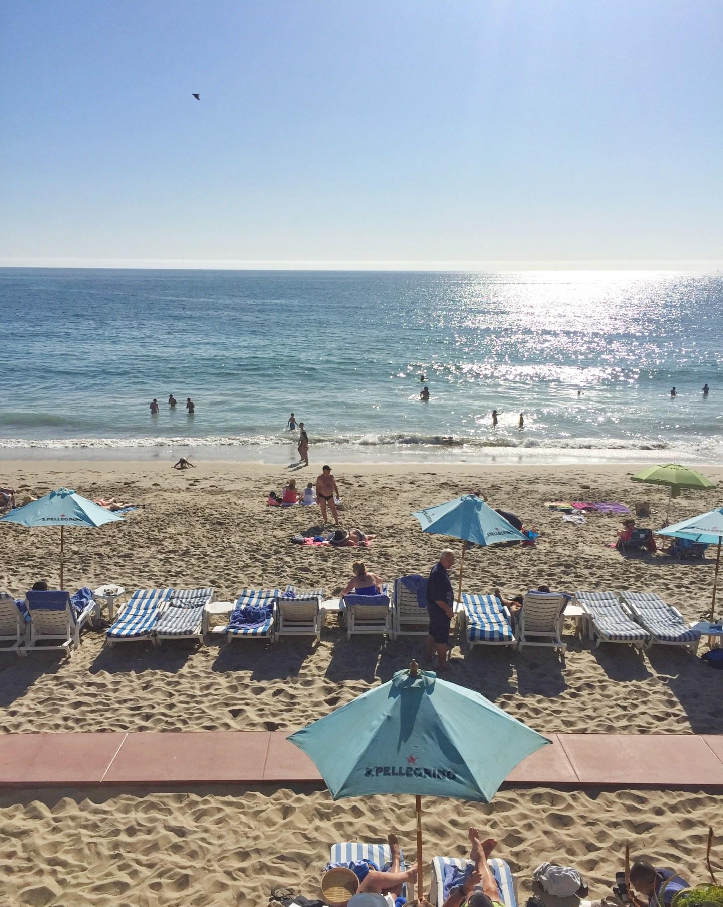Sunbathers at Laguna Beach on a sunny day - Southern California