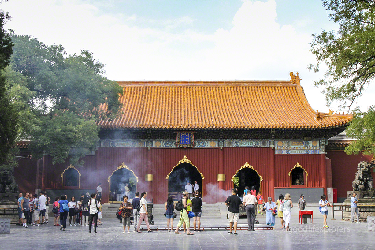 Worshippers burn incense at the Lama Temple front entrance.