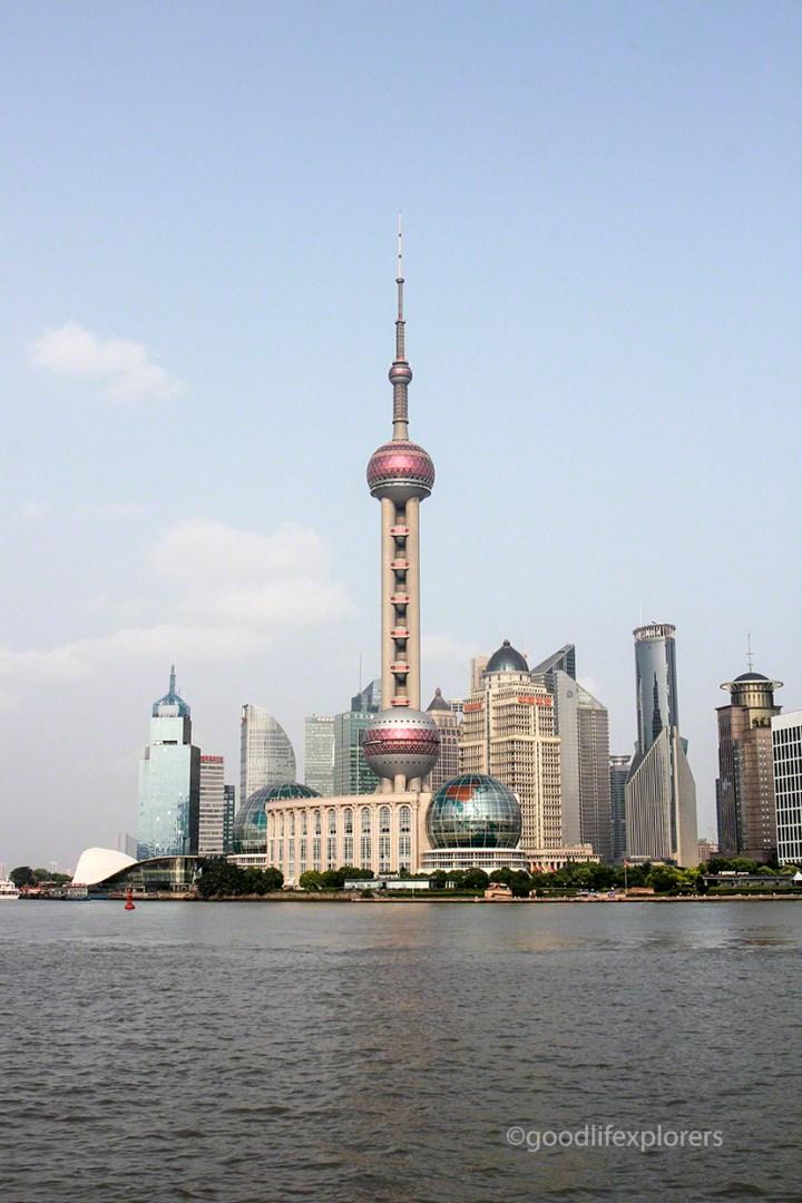 The Oriental Pearl Tower in Shanghai seen from The Bund sidewalk