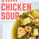 Thai Chicken Soup in a white bowl against white marble