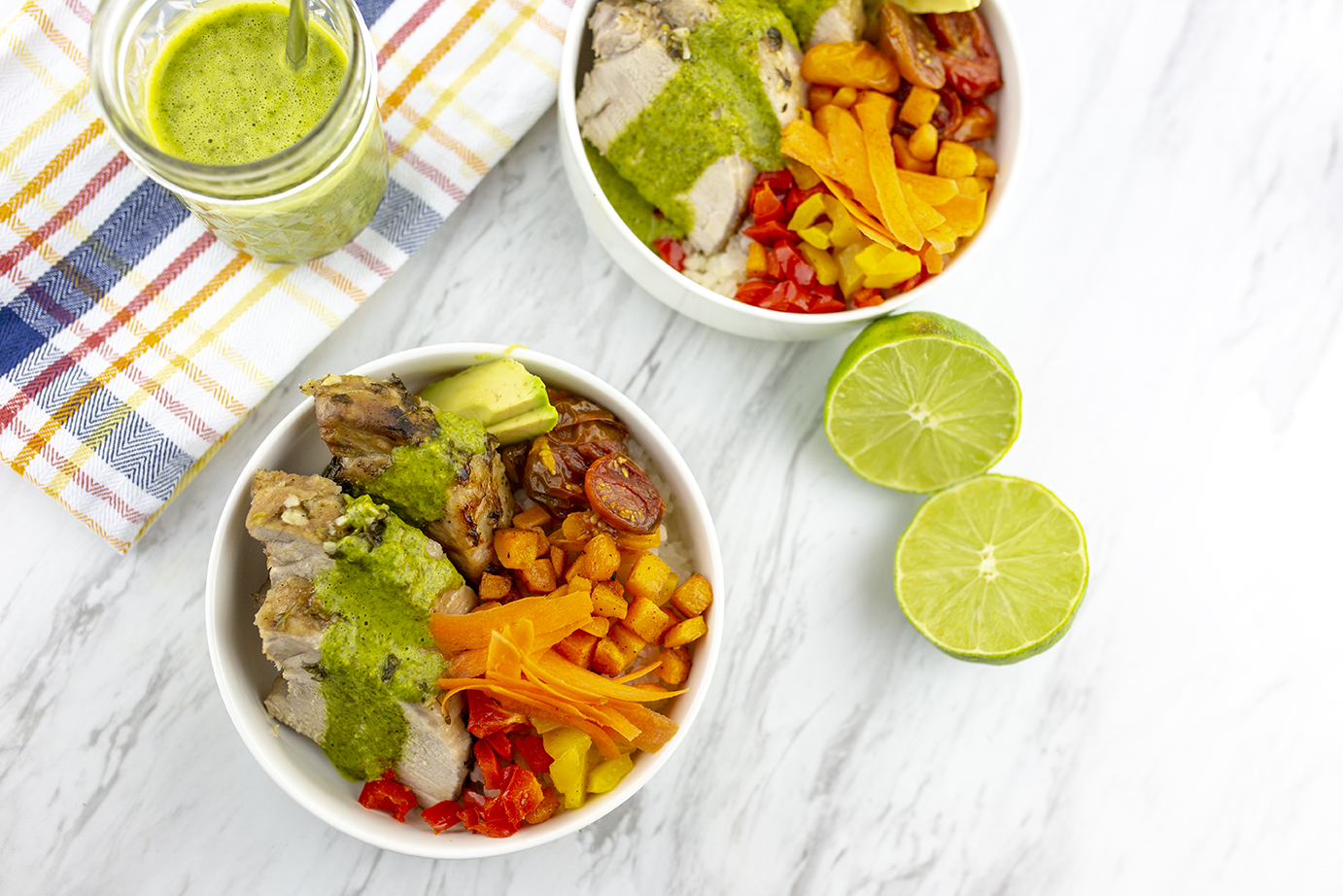 Two bowls of Cilantro lime pork and roasted vegetables