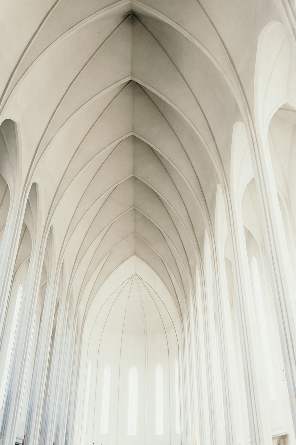 Inside Hallgrimskirkja church in Reykjavik. The ceiling is all white with vaults and huge columns