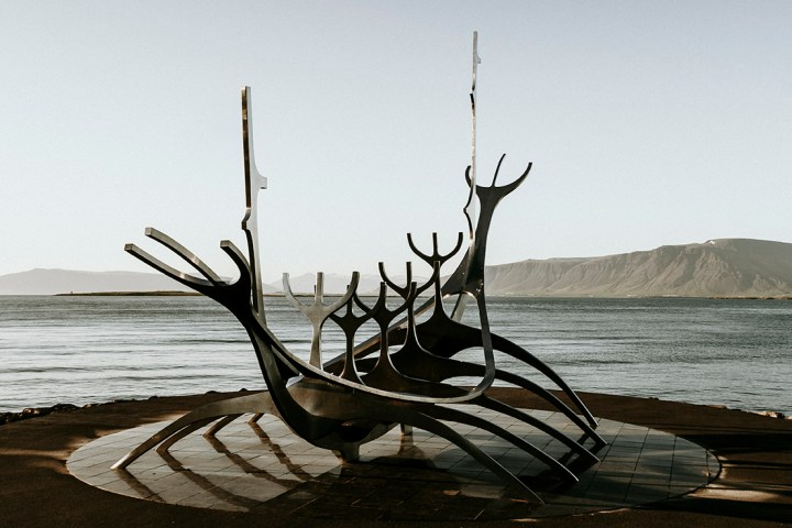 Sun voyager sculpture sitting on the bay of Reykjavik Iceland. The sun voyager is a metal sculpture that resembles a viking boat.