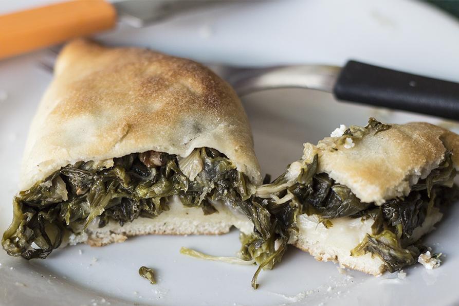 Esfiha de escarola or Escarole Esfiha - a baked Brazilian snack filled with vegetables or meat and cheese.