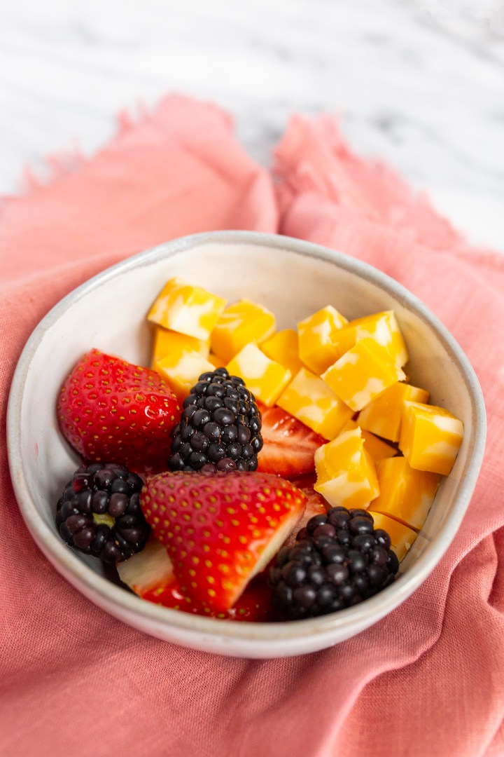 Cheese with strawberries and blackberries