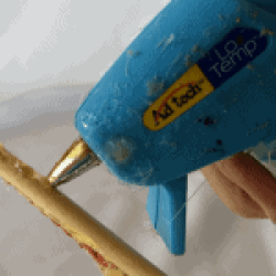 glueing the dowel to the rocket